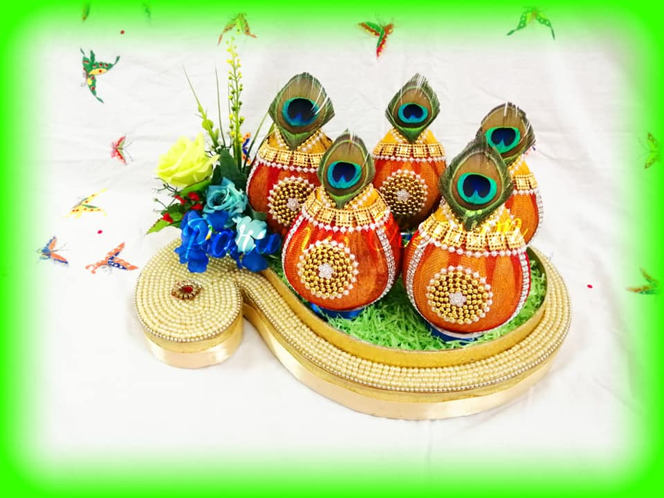 Coconut plate decoration with peacock feather