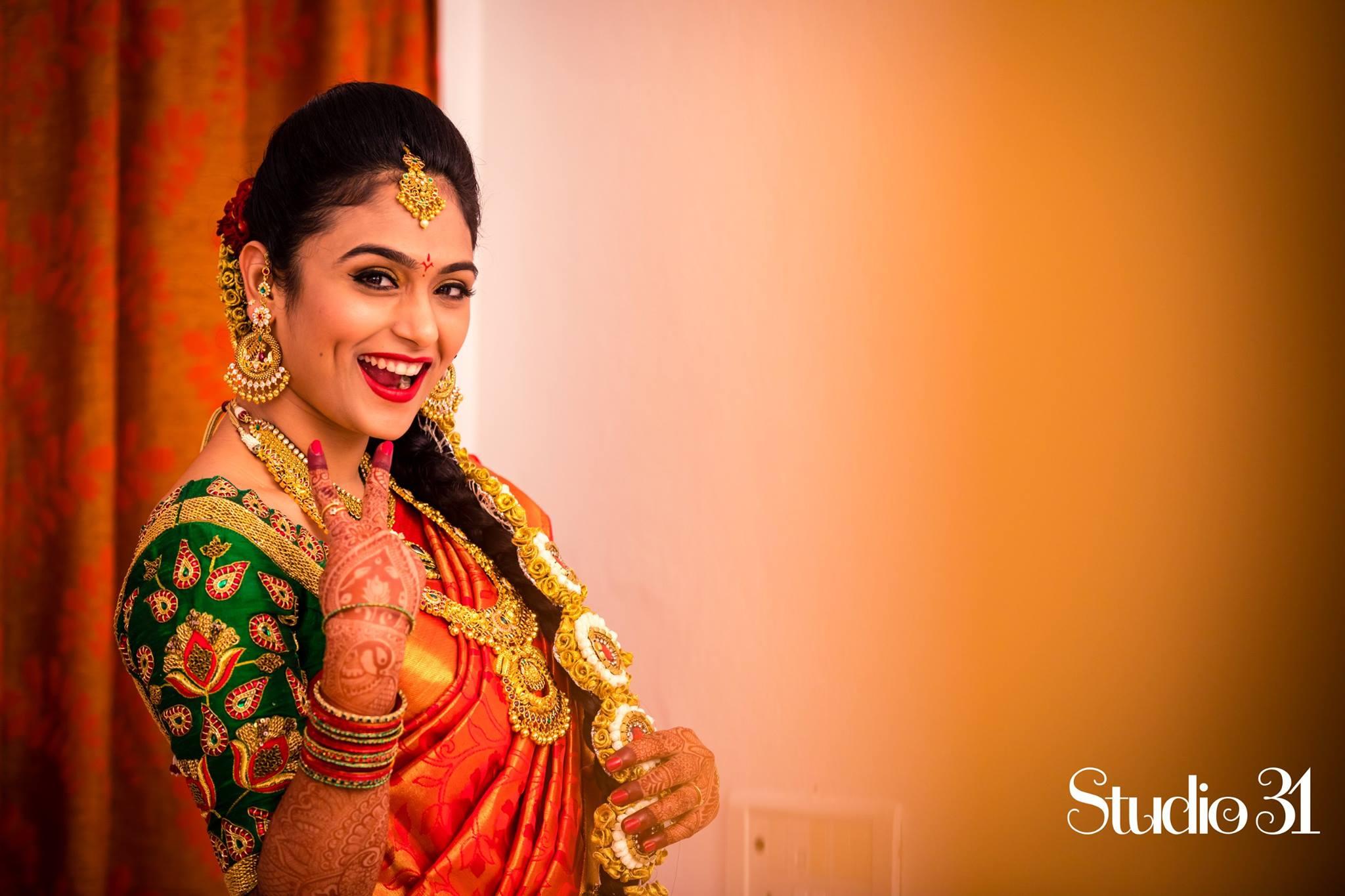 Red silk saree with Green Stine work blouse