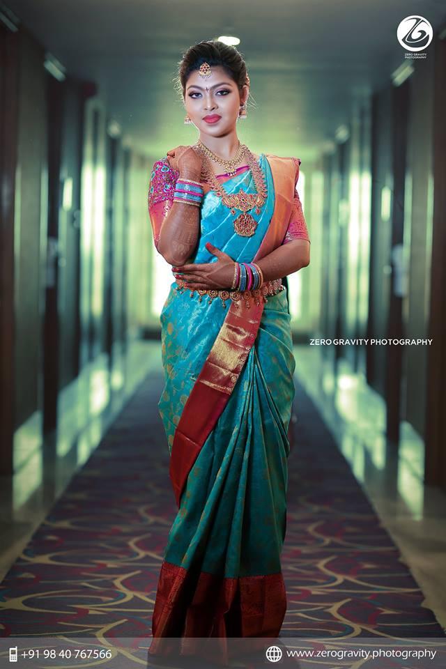 Blue kancivaram Silk saree with pink border