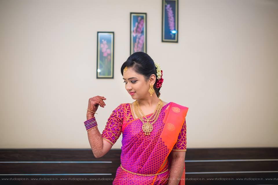 Purple with orange silksaree for a bride