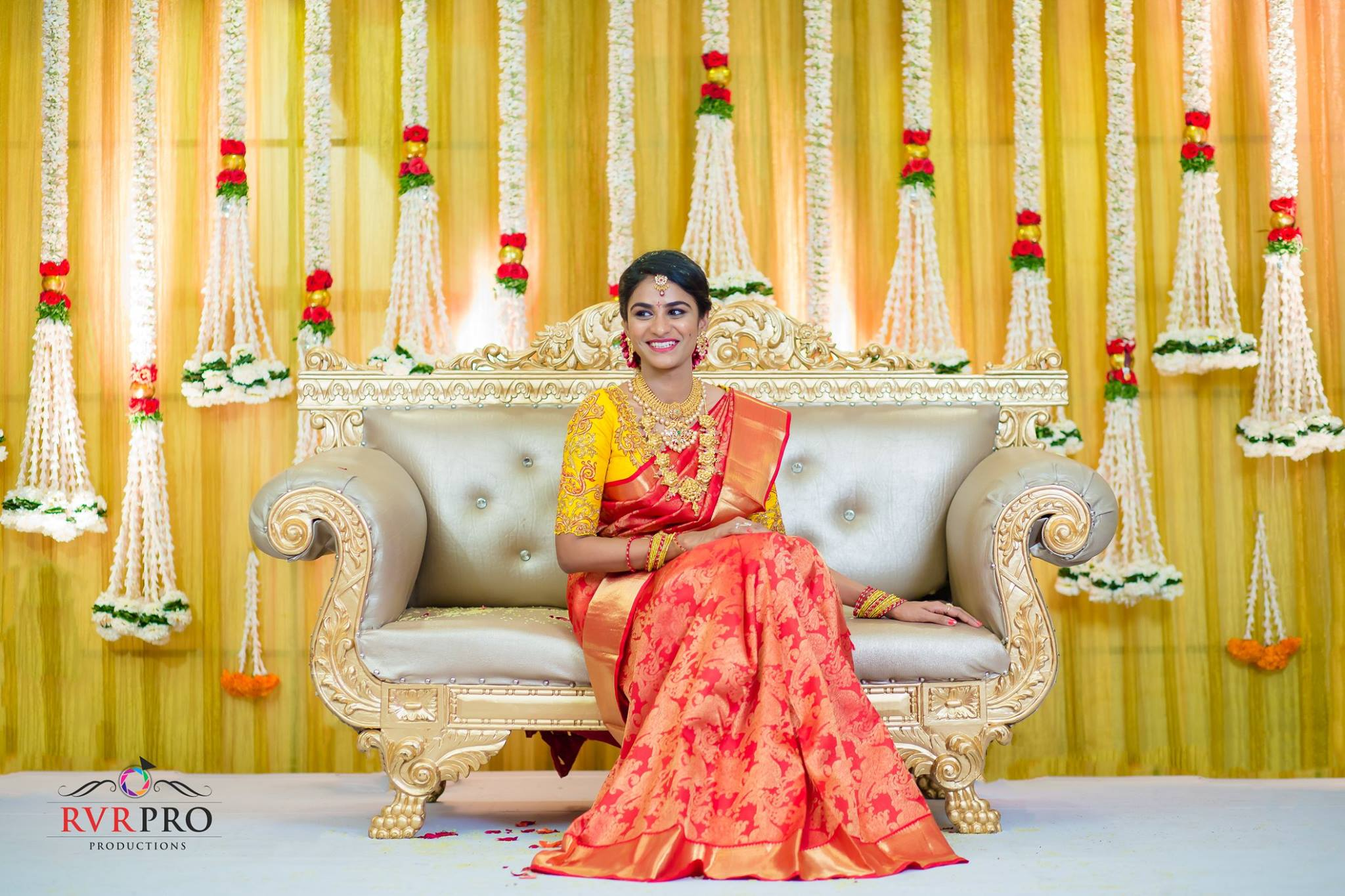 Red silk saree with contrast yellow Blouse