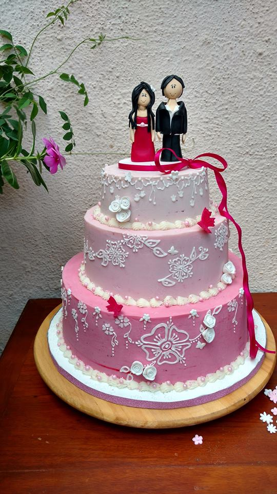 Couple cake with pink ombre effect with delicate white piping