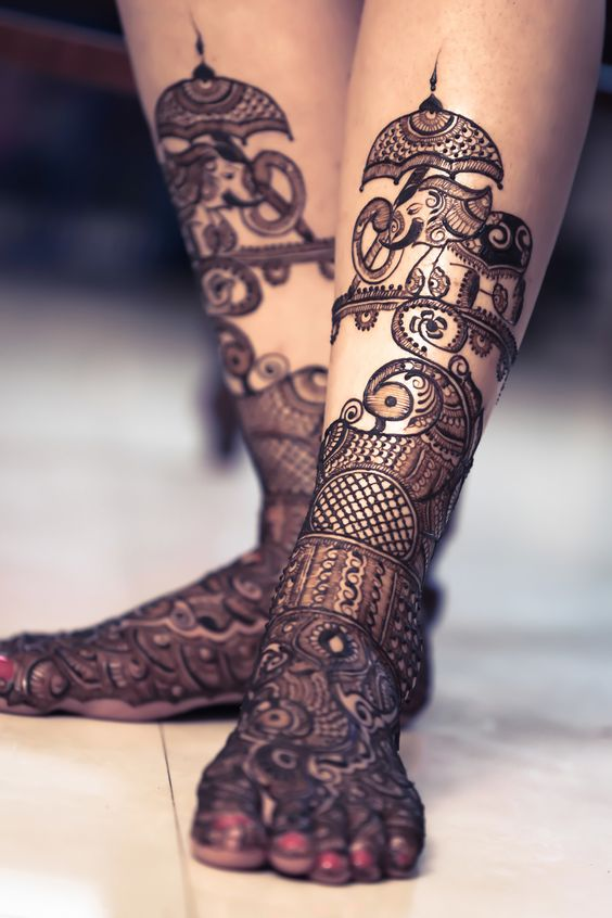 Elephant and peacock design feet mehndi