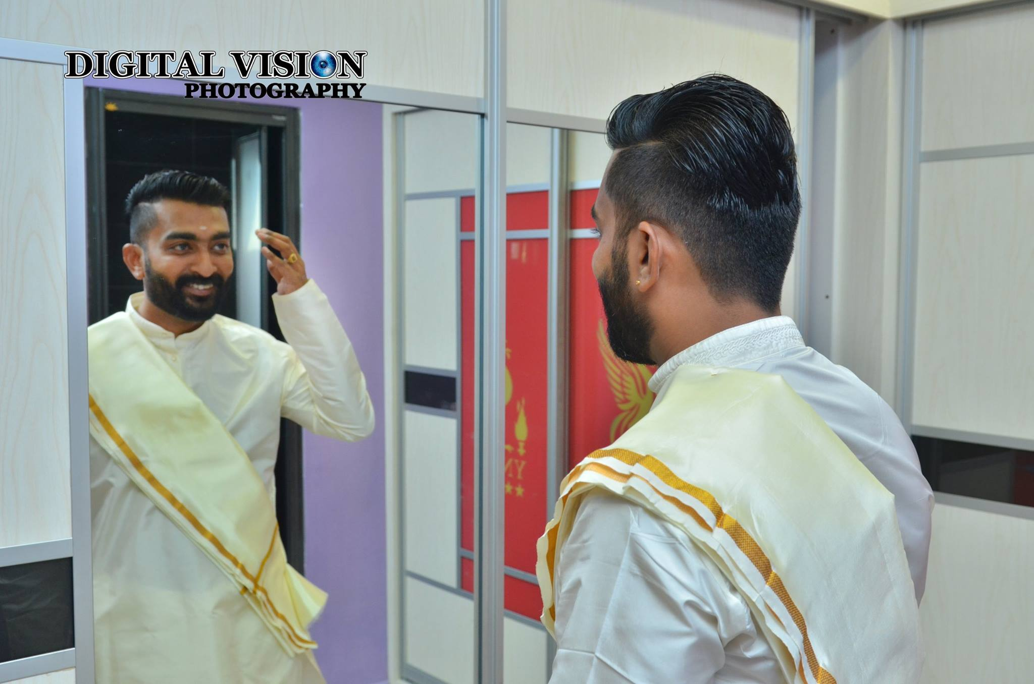 White traditional Groom outfit