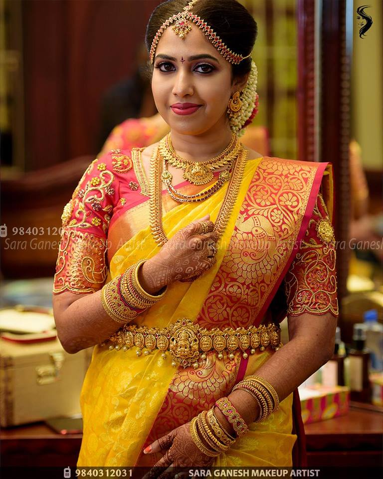 Yellow with Red peacock border silksaree