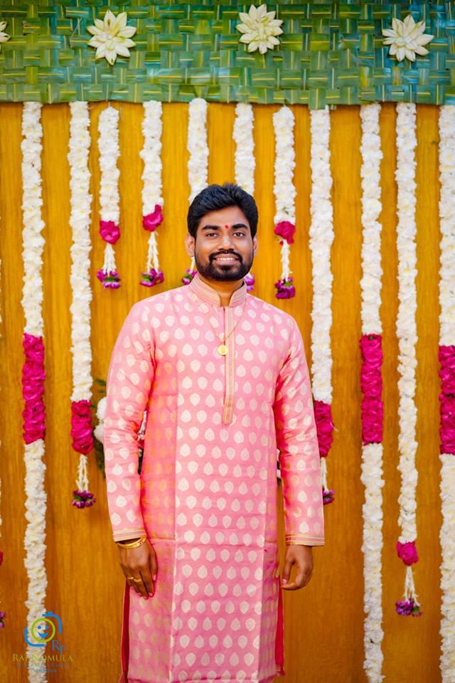 Pink sherwani with gold butta's