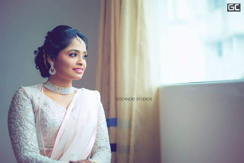 Pretty bride in white outfit