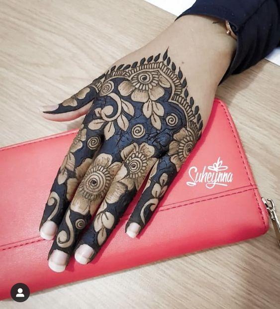 Flower mehndi design for back hand