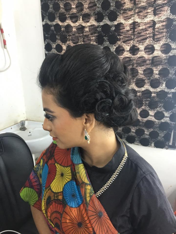 Spiral Bun Hairstlye For Black Lehenga Photo Gallery